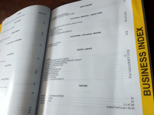 Pages of the actual book showing the business index with page numbers of advertisers